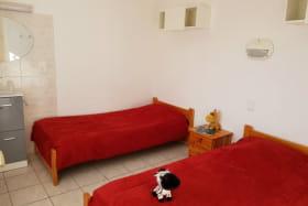 La chambre rose avec ses 2 lits
