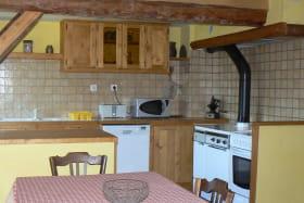 Location maison dans les Bauges - cuisinière bois