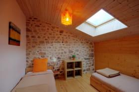 Chambre Mandarine avec 2 lits 90 x 190